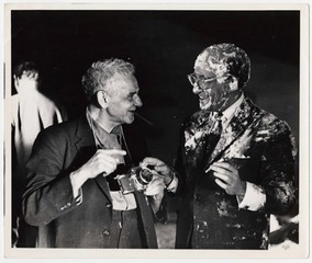 Weegee and Peter Sellers after the famous pie scene on the set of Dr. Strangelove or: How I Learned to Stop Worrying and Love the Bomb,