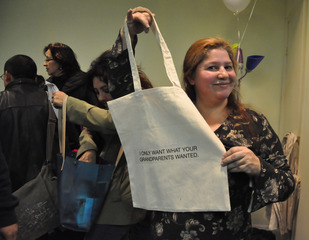 Immigrant Movement International - Maria with logo bag , Tania Bruguera