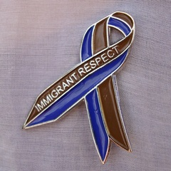 Awareness Ribbon for Immigrant Respect Campaign   , Tania Bruguera