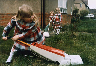 Untitled (Girls in Plaid \'Hoovering\' the Lawn) from the series Living Room , Nick Waplington