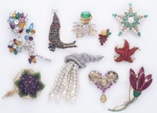 Selection of brooches and a clip earring from the Fior Collection, London,