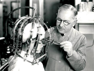 Max Factor adjusting his Beauty Calibrator,