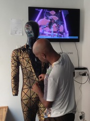 Jacolby getting his bodysuit on a mannequin for the window display at Recess,Jacolby Satterwhite