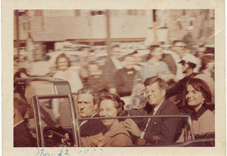 Governor John Connally, Nellie Connally, President John F. Kennedy, and Jacqueline Kennedy in presidential limousine, Dallas,