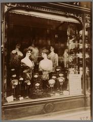 Hairdresser\'s Shop Window, boulevard de Strasbourg  , Eugene Atget