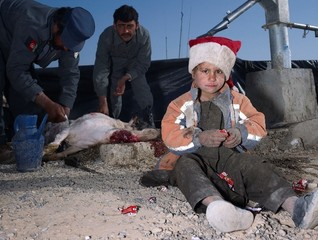Child, Jacket, Slaughtered Goat, Sweets, Painted Nails, Xmas Day, Helmand, Mark Neville