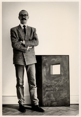 Jörg Johnen with the poster of the gallery\'s first exhibition in Cologne in 1984,