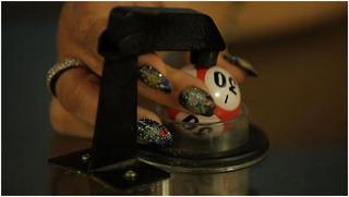 Still from Bowls Balls Souls Holes, Mika Rottenberg