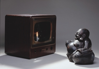 Buddha Looking at Old Candle TV, Nam June Paik
