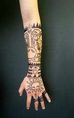 20141215200315-msm-tattoo2-1