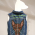 20150907103938-lisa_kokin_chihauhua-americans_against_the_war__from_the_installation__put_it_on_the_dog___denim_vest__beads__hand_embroidery__36_x_10_x_8_inches_2005_01
